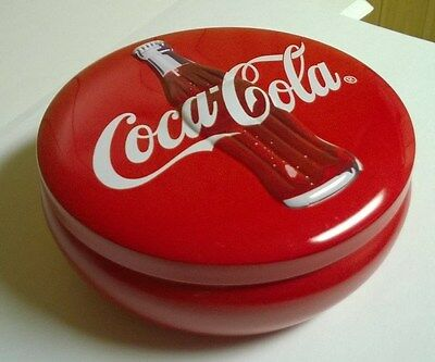 Coca Cola Round Red Tin with Coke Bottle Embossed on top of Tin
