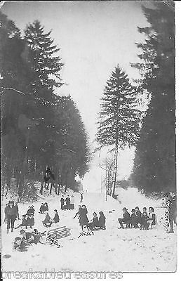 NICE VINTAGE POSTCARD (1916) PHOTO OF PEOPLE IN A SWISS MOUNTAIN SLEDDING