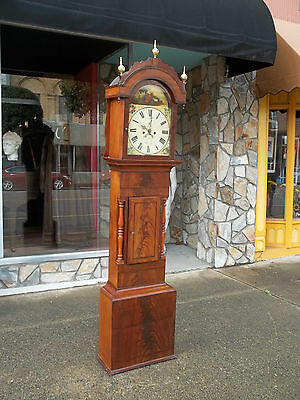 Outstanding English Mahogany Tall Case Clock with a Painted Dial 19th century.