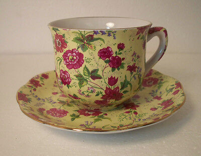 Charlotte China (Made In China) Cup & Saucer Pink Chintz Flowers Yellow Bckgrd