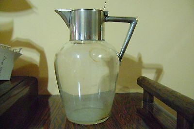 vintage WMF jugs pitchers Silverplate and glass.