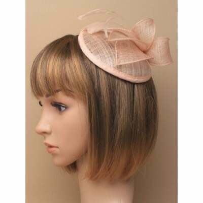 Peach fascinator with hessian petals and feathers set on clear comb.