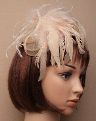 Light brown beige fascinator with net and feather tendrils on alice hair band