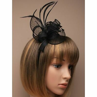 Black fascinator with hessian flower, petals, and feather tendrils on alice h...
