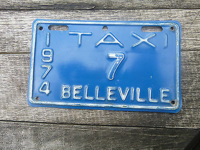 1974 Belleville  Ontario  Taxi Low # 7 license plate
