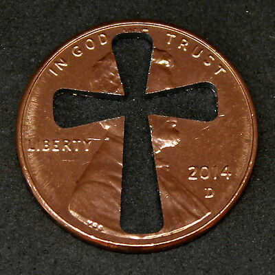 Lucky penny with cross cut out