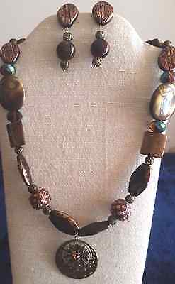 """The Medallion-24"""" Various Brown Glass Beads with a Medallion with matching earri"""
