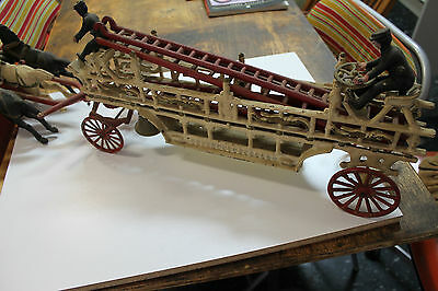 Antique Toys--Reproduction Cast Iron Horse Drawn Fire Tender.