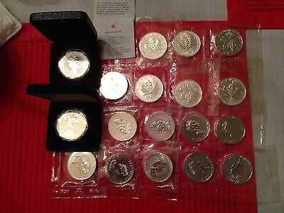 18 Canadian 1 Ounce Silver Maple Leafs from 1988-2000. All silver Maple Leafs