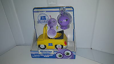 Monsters University Roll A Scare Randy ridez yellow car Spin Master