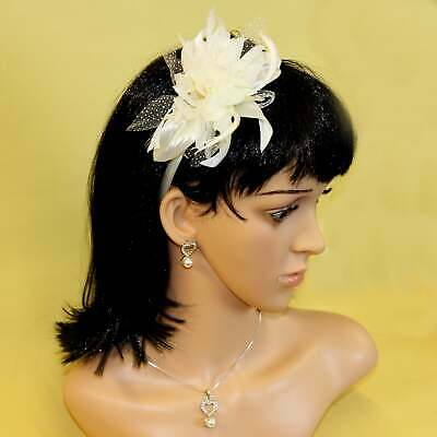 Cream white fascinator chiffon flower on alice hair band with feather tendrils