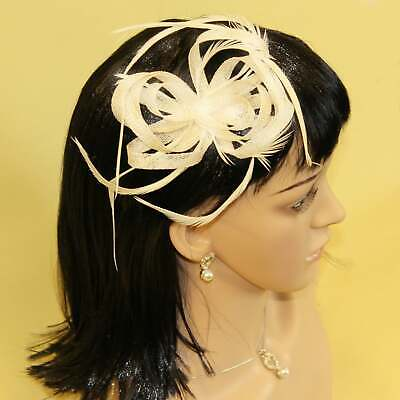 Cream fascinator with hessian loops and feather tendrils (beak and clip)