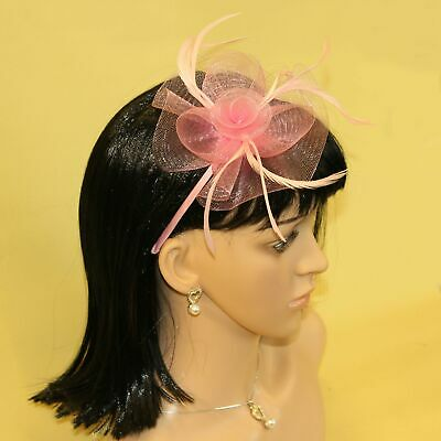 Pink fascinator with sinamay flower and feather tendrils on alice hair band