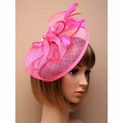 Pink fascinator with hessian petals and feather tendrils (beak clip)