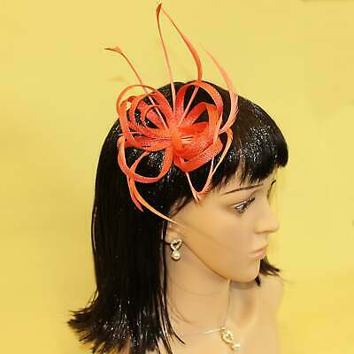 Coral red fascinator with hessian loops and feather tendrils (beak and clip)