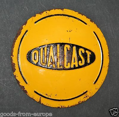 """antique QUALCAST tractor or lawn mover tin sign or hubcap 4.75"""" arched embossed"""