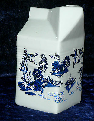 Milk carton shaped jug off white ceramic decorated with blue willow pattren