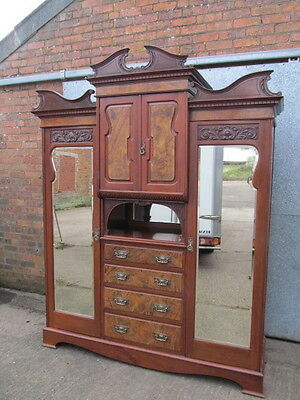 Edwardian walnut castle top compactum wardrobe