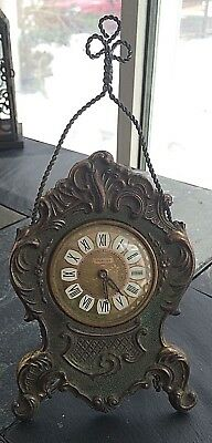 Antique Cast Iron Splendex Wind Up Kitchen Clock on wire stand.