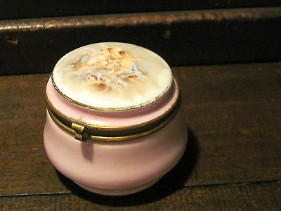 Antique pink enamel powder box with cherubs painted on top