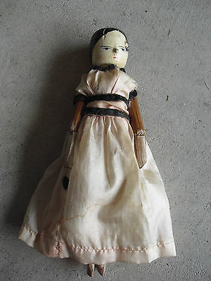 """Late 1800s Wood Peg Jointed Girl Doll in Period Clothes 9 1/2"""" Tall"""