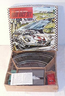 GRAND PRIX OVER AND UNDER SLOT CAR SET BOXED SEALED 1960s WITH CARS