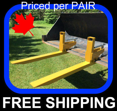 "PAIR of clamp on to bucket Pallet Forks, 2000 lb capacity, 32"" usable"