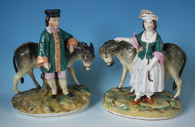 Pair Staffordshire boy & girl with donkey figures