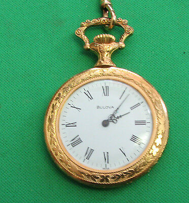 Bulova Pocket Watch made suiss Gold color 17 jewels work fine come with chain