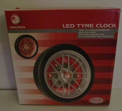 Holden new in box rotating LED tyre wall clock for home bar brew or collector
