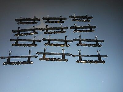 Lot of 12 Metal Drawer Pulls. Rd. 1971