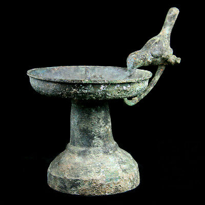 A Byzantine bronze candle holder with avian handle.  Ca 7- 9th Century, y921