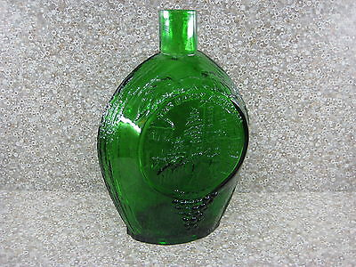 The Early American Society Green Glass Bottle