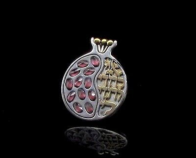 A Silver Pomegranate Pendant With Garnets And Hebrew Inscription In Gold