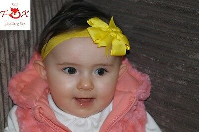 Lovely Soft And Elasticated Baby Girls Pinwheel Bow Headband