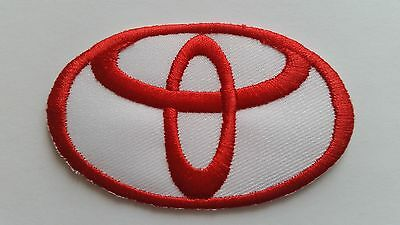 NISSAN MOTOR RACING CAR SPEED FESTIVAL SEW ON IRON ON PATCH: a RED OVAL