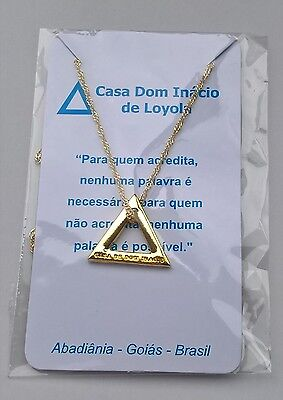 Triangle pendant from casa dom inacio, blessed by John of God