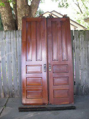 Antique Pocket Doors and salvaged interior trim dark wood tone