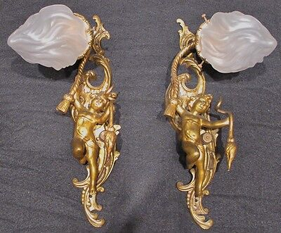 Matched Antique Pair of Bronze Cherub Sconces with Flame Shades circa 1900s