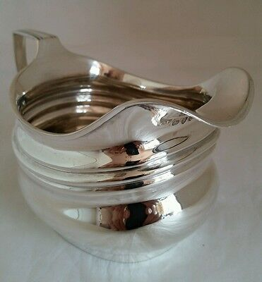 A George III sterling silver cream jug. London 1809. By Crispin Fuller
