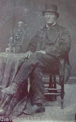 Tintype /  Older Gentleman with Hat / Table with plant and elephant