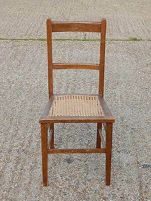 Antique beech wood dining chair with woven wicker strung seat and leg stretchers