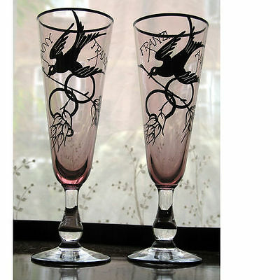 An unusual pair of Friendship Champagne Flutes decorated with birds