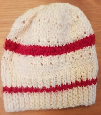 Worn Child's Woolly Hat. white with red stripes - 0-6 mths