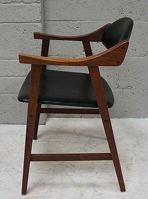 A mid - late 20th century black leather and rosewood open arm chair.