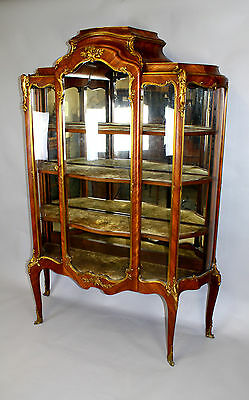A French Kingwood & Ormolu Mounted Bombe Form Vitrine Attributed To Paul Sormani