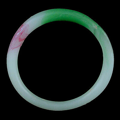 A Qing Dynasty green and white glass bracelet. Made to imitate jadeite. x9109