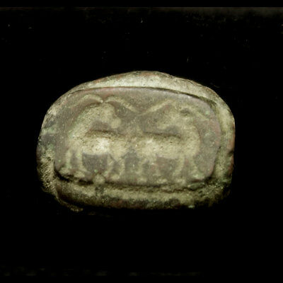 A Bactrian bronze bead with representation of two goats y167