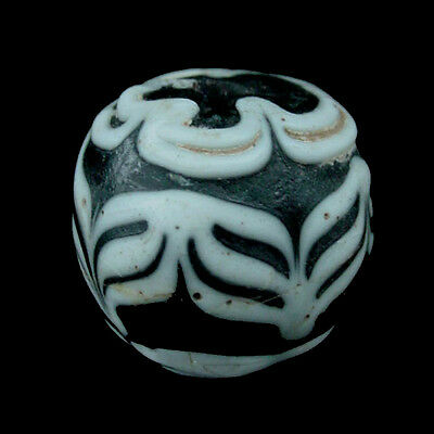 An Islamic glass bead. e8234