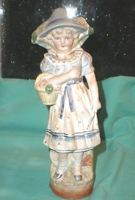 antique figurine of a girl with hat and basket antique/ bisque/Germany